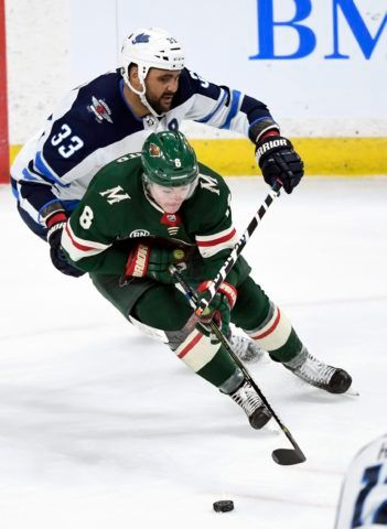 Minnesota Wild's Ryan Donato Winnipeg Jets' Dustin Byfuglien