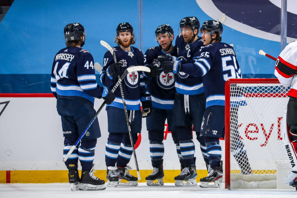 Winnipeg Jets Kyle Connor celebrates with Blake Wheeler, Mark Scheifele, Paul Stastny, and Josh Morrissey
