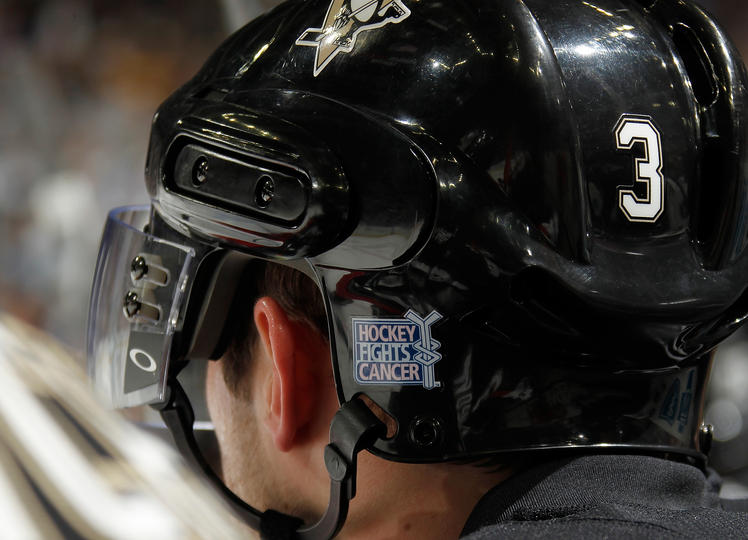 Alex Goligoski, then of the Pittsburgh Penguins, wears a Hockey Fights Cancer sticker on his helmet during a game on October 18, 2010.