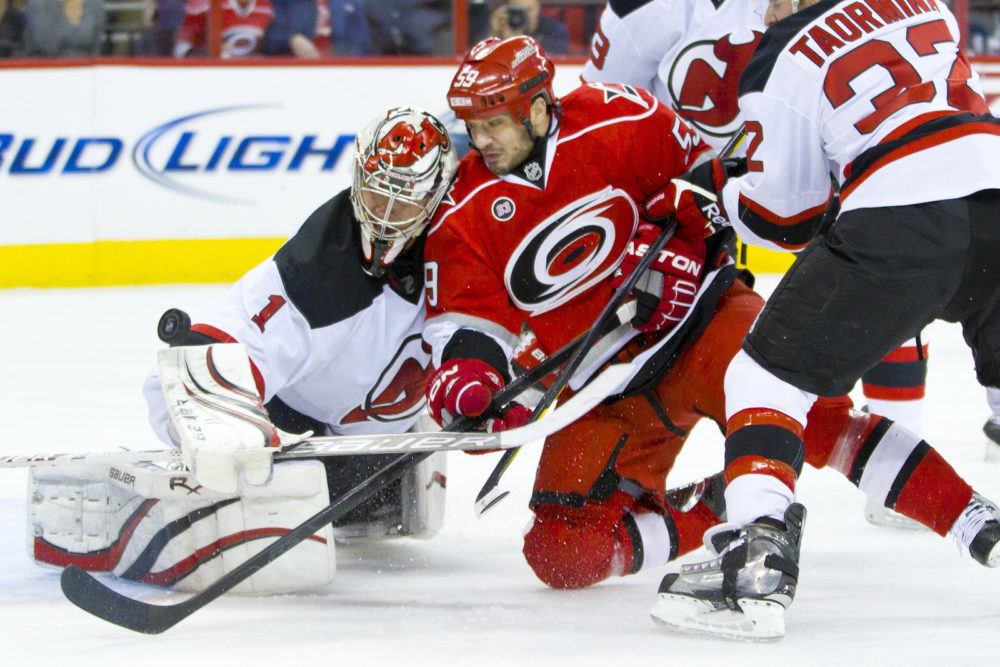 New Jersey Devil Johan Hedberg, Carolina Hurricane Chad Larose -