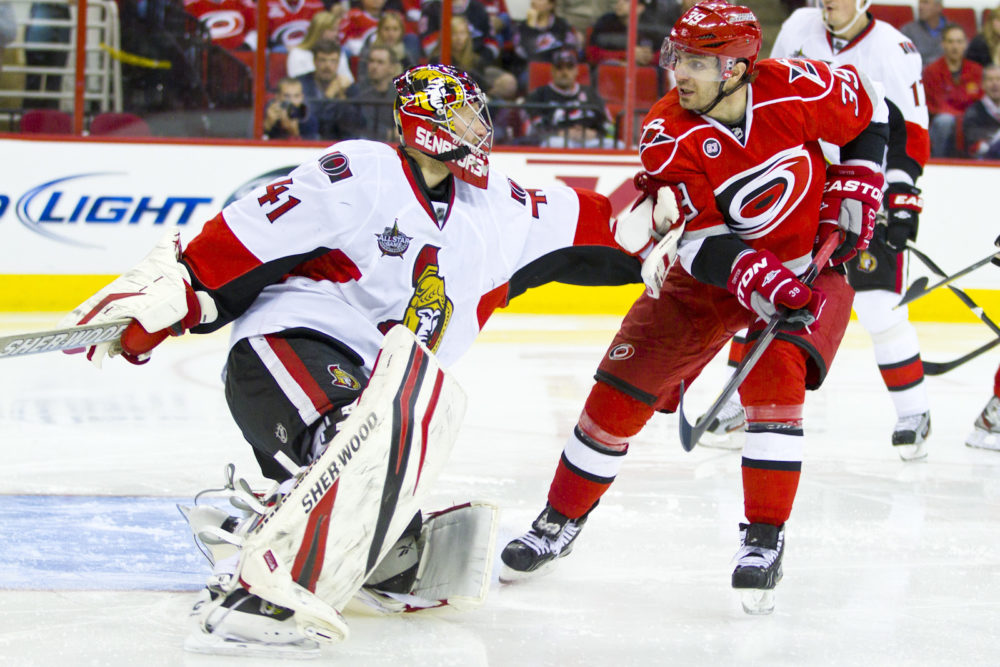 Ottawa Senator - Craig Anderson, Carolina Hurricane Patrick Dwyer - Photo by Andy Martin Jr