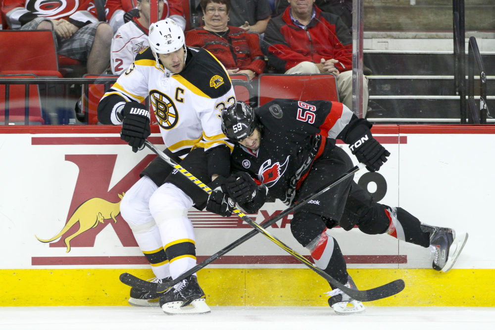 Boston Bruin Zdeno Chara, Carolina Hurricane Chad Larose - Photo