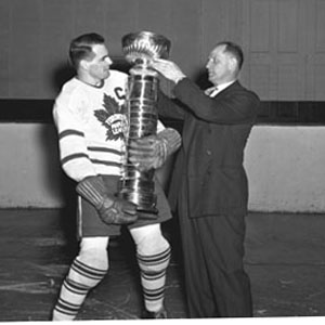 Syl Apps receiving the old 'stovepipe' version of the Stanley Cup.
