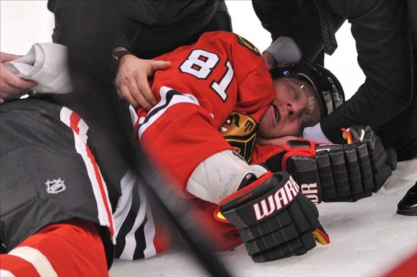 torres hit on hossa