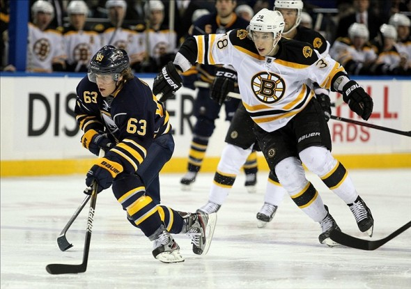 Jordan Caron of the Boston Bruins chasing Tyler Ennis (Timothy T. Ludwig-US PRESSWIRE)