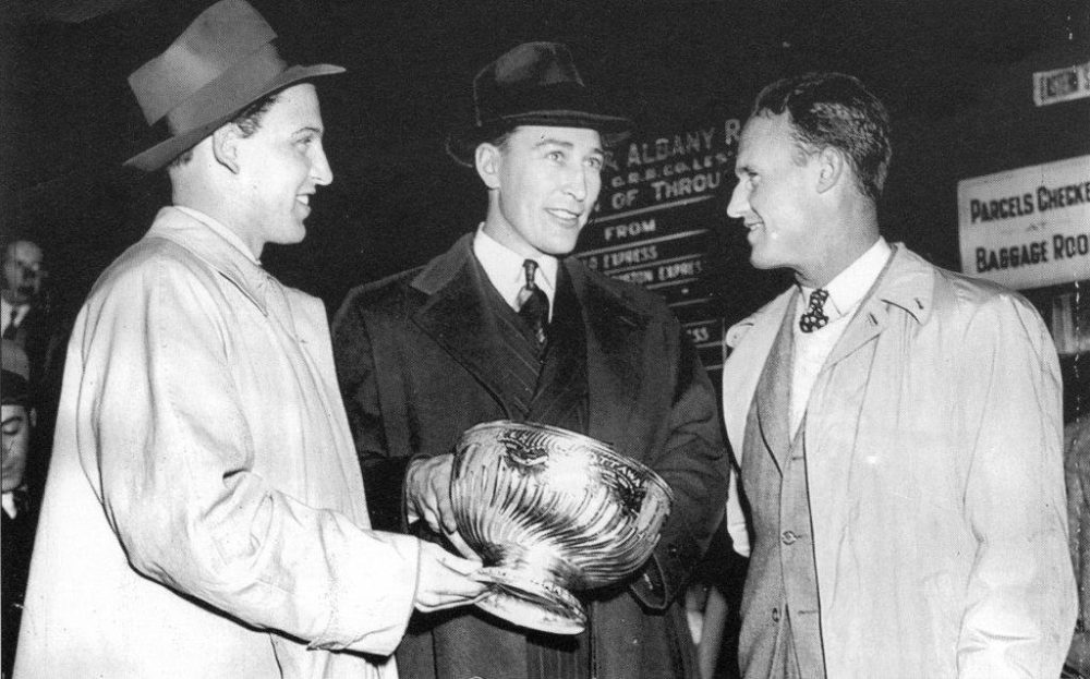 Dit Clapper (center), Bill Cowley and Jack Crawford of the Boston Bruins holding the Stanley Cup in 1941. (Courtest of Stewart Richardson and The Sports Museum)