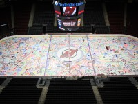 Devils and Prudential Center family and friends paint the ice. (Kerry Graue -- New Jersey Devils)