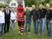 """(L-R) Ed Heitin, PwC Partner and New York Metro Green Team Leader; Joseph N. DiVincenzo, Jr., Essex County Executive; Lisa Simms, Executive Director of the New Jersey Tree Foundation; Jim Leonard, Senior Vice President of Community Investment, Devils Arena Entertainment; and Devils alumni Ken Daneyko, Grant Marshall and Bruce Driver join NJ Devil at Presby Memorial Iris Gardens in Upper Montclair, New Jersey for today's tree planting event as part of the """"Pucks for Parks"""" initiative. (Kerry Graue / New Jersey Devils)"""