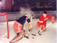 Red Wings' Gordie Howe gives a Ranger goalie a snow shower