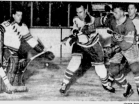Ranger goalie Marcell Paille  watches as Harry Howell holds off Montreal's Dave Balon