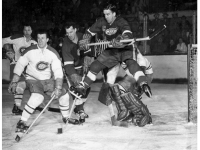 Ted Lindsay screens Jacques Plante as Howe, Harvey look on