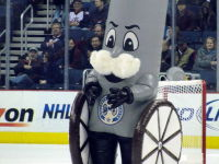 A mustachioed walking cannon with superfluous wheels? Hockey fans enjoy funny mascots and clever tweets.  Credit: By Michael Miller (Own work) via Wikimedia Commons