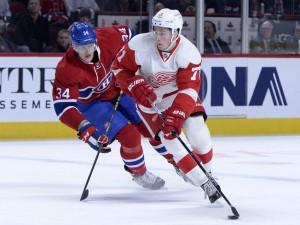 Montreal Canadiens forward Michael McCarron and Detroit Red Wings forward Dylan Larkin